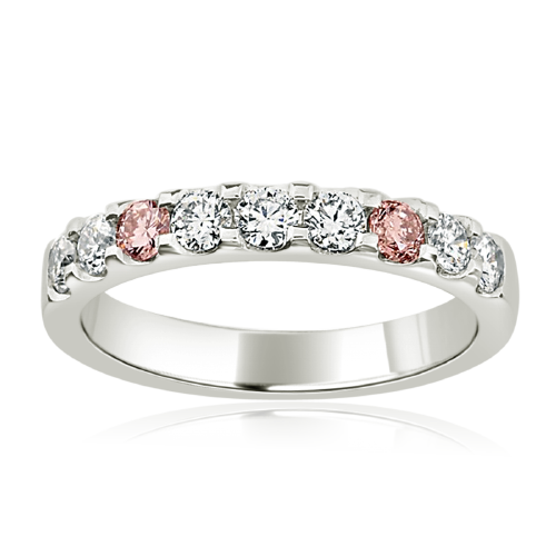 Round brilliant cut diamond wedding ring with pink diamonds